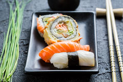 Closeup of fresh sushi, dark ceramic and chopstick Royalty Free Stock Images