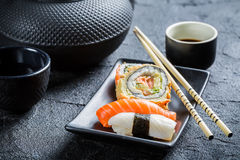 Closeup of fresh sushi served in with tea Stock Image