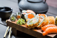 Closeup of fresh sushi on wooden board Stock Images