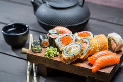 Closeup of fresh sushi on wooden board Stock Photo