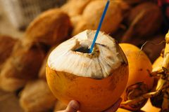 Closeup of yellow coconuts For Sell On Street. Closeup of fresh yellow coconuts For Selling On Public Street Royalty Free Stock Photo