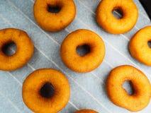 Closeup of freshly made dark brown doughnuts Royalty Free Stock Photo