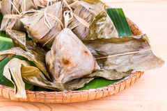 Closeup on freshly steamed Chinese rice dumpling on traditional rattan tray Stock Images