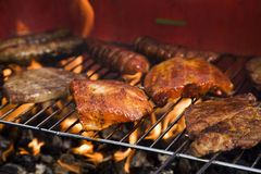 Closeup of fried meat on grill Stock Photos