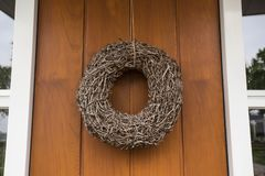 Closeup of front door and decorative wreath royalty free stock photography