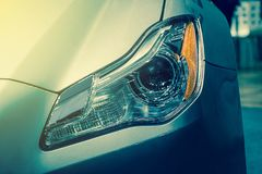 The Closeup Front Headlight car Royalty Free Stock Images