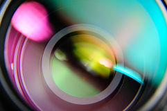 Closeup front of lens. Abstract closeup front of lens with pink and turquoise reflection Royalty Free Stock Photos