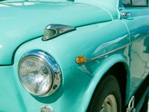 Closeup front part of old vintage soviet russia car. Closeup front part of old vintage soviet russia white car in turquoise color royalty free stock photos