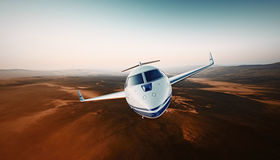 Closeup Front View White Luxury Generic Design Airplane.Private Jet Cruising High Altitude, Flying Over Mountains.Empty Stock Image