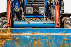 Closeup frontal view of an old wheel tractor, isolated Stock Photo