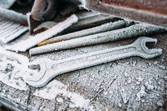 Closeup of frosted adjustable wrenches stock photos