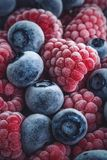 Closeup of Frozen Raspberries and Blueberries stock images