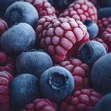 Closeup of Frozen Raspberries and Blueberries royalty free stock photography