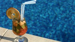 Closeup of fruit cocktail on pool deck, summer refreshment, relax on vacation Royalty Free Stock Photos
