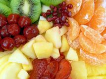 Closeup of fruit salad. Strawberries, mango, cherries, pomegranate, orange, apple, pineapple and kiwi fruit Royalty Free Stock Image
