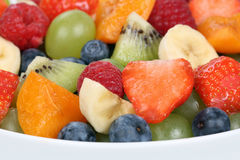 Closeup fruit salad in a bowl with strawberries, blueberries and Stock Images