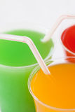 Closeup fruity drinks with straws Royalty Free Stock Photography