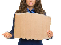 Closeup on frustrated business woman showing blank cardboard Royalty Free Stock Images