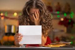 Closeup on frustrated housewife with letter Stock Photography