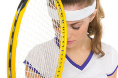 Closeup on frustrated tennis player with racket Royalty Free Stock Images