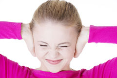 Closeup of frustrated young woman holding her ears. Stock Photography
