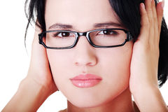 Closeup of frustrated young woman holding her ears Stock Photos