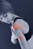 Closeup of ftiness woman with muscle pain. Closeup of fitness girl with biceps pain, isolated Stock Photography