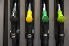 Fuel pistols on the petrol station. Closeup of the fuel pistols on the petrol station royalty free stock photography