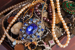 Closeup of full treasure chest. With jewellery Stock Images