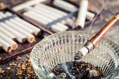 Closeup of fuming a cigarette in the old pipe Royalty Free Stock Images