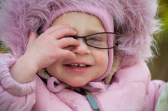 Closeup of funny baby in glasses Stock Photography