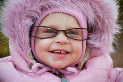 Closeup of funny baby in glasses Royalty Free Stock Images
