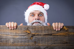 Closeup of a funny  man with frozen beard wearing santa red cap Stock Images