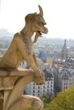 Closeup of gargoyle on the Notre-Dame de Paris. Closeup of gargoyle on the top of Notre-Dame de Paris. Paris, France Royalty Free Stock Photo