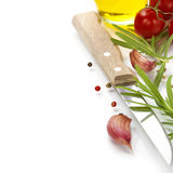 Closeup of garlic,rosemary, tomatoe, olive oil  and knife Stock Photos