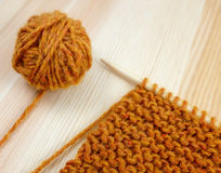 Closeup of garter stitch knitting and orange wool Royalty Free Stock Photography