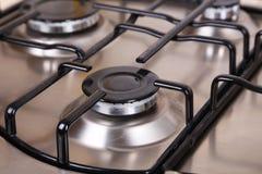Closeup gas stove, hot fire Stock Photos