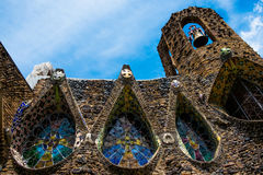 Closeup of gaudi colonia guell church in modernist style in sunny day. Ancient decorated walls of modernist gaudì church in spain in sunny day royalty free stock image