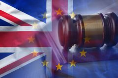Closeup gavel on background of overlapped flags. Of Great Britain and European Union royalty free illustration