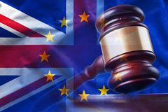 Gavel on background of British and European Union flags. Closeup gavel on background of overlapped flags of Great Britain and European Union stock illustration