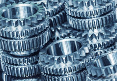 Closeup gears. Close-up of interlocking industrial metal gears Stock Images