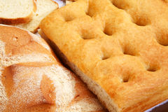 Closeup of genoese focaccia and bread. Royalty Free Stock Photos