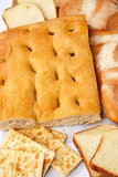 Closeup of genoese focaccia, bread and crackers. Royalty Free Stock Photography
