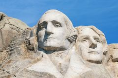 Closeup of George Washington and Thomas Jefferson. Presidential sculpture at Mount Rushmore National Monument, South Dakota, USA. Stock Photos