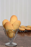 Closeup giant lady finger cookies in a dish Royalty Free Stock Photo