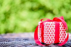 Closeup a gift box with red ribbon. Holidays, present. Christmas, and happiness concept royalty free stock images