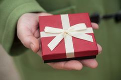 Gift with ribbon in woman hand - valentines day conce Stock Image