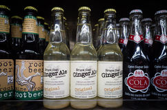Closeup of Ginger Ale, Root beer and Cane Sugar Cola bottles on stock photography