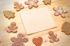 Closeup of gingerbread biscuits with blank paper Stock Photography