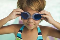 Closeup Of A Girl Adjusting Goggles Stock Photo